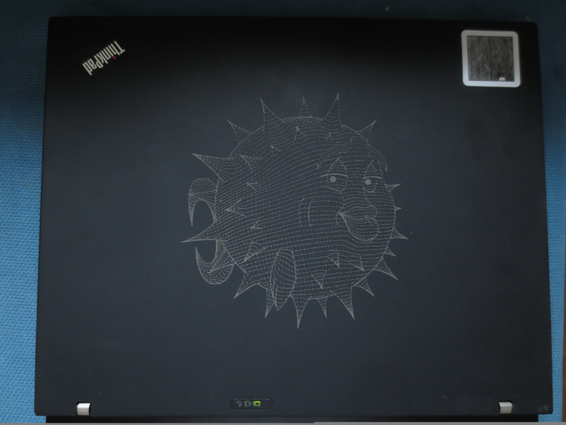 laptop with OpenBSD pufferfish cut into the lid
